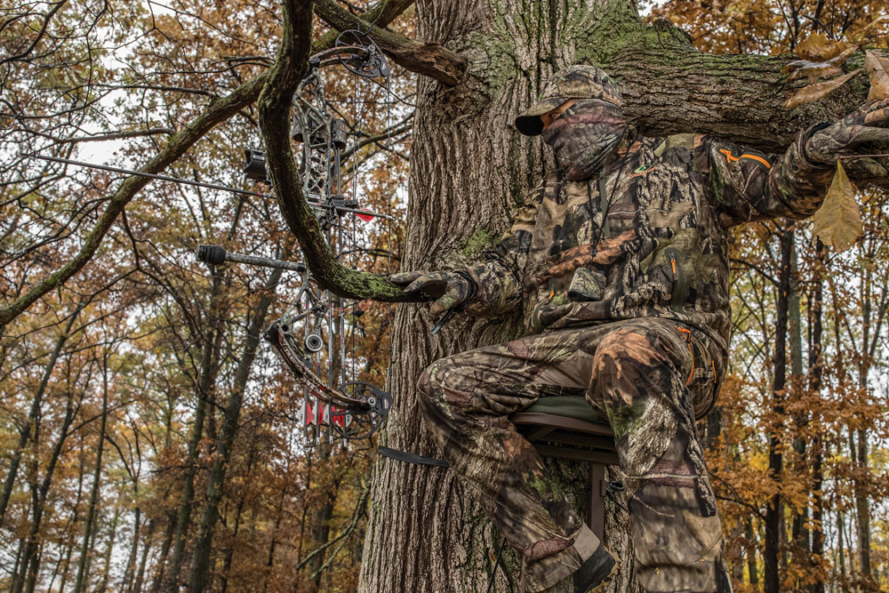 deer hunter in treestand with bow