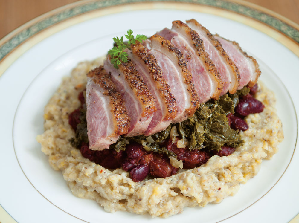 roast duck over beans and grits
