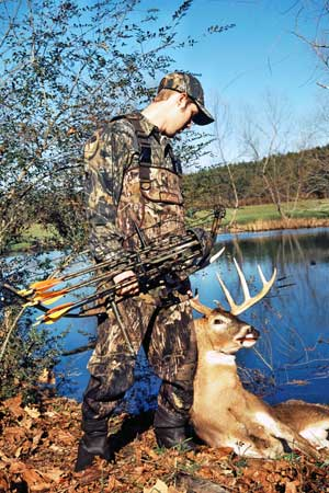 bowhunter with buck