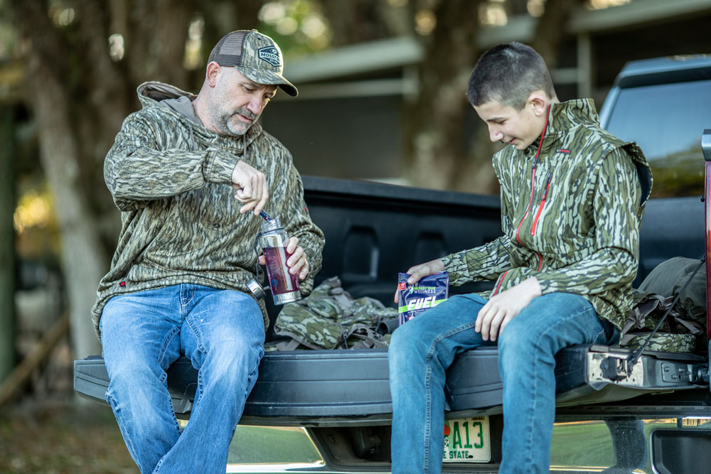 dad and son on tailgate