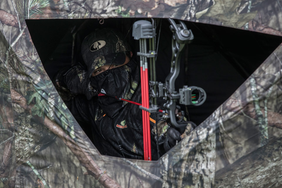 bowhunter in ground blind