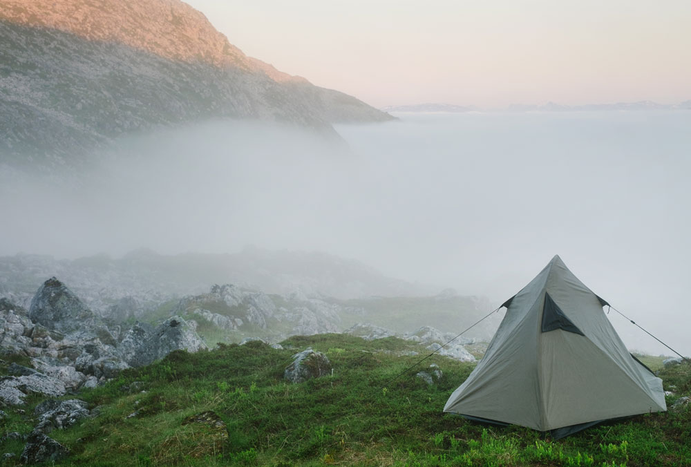 tent in foggy mountains
